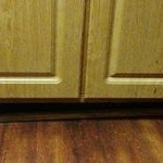 Baseboard falling off in kitchen