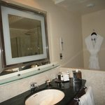 Large lighted mirror in bathroom, complimentary Frette robe  &  slippers