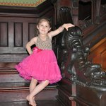 My granddaughter by the dragon stairway