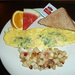 Spinach, tomato, and Romano cheese omelette.