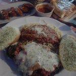 Chicken Parmesan w/ spaghetti & Chicken wings in background