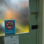 No smoking in room. Door has safety latch. Frosted glass for privacy.