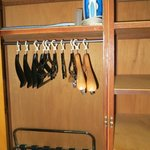 Clothes hangers, luggage rack, iron, ironing board