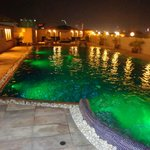 The roof top pool at night