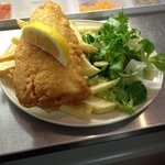 freshly cooked haddock and hand cut chips with fresh green salad