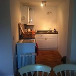 kitchen area with lovely picnic basket and fridge full of goodies to make a continental breakfas