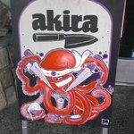 Akira sign board with knife-wielding sushi prep octopus