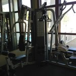 corner of fitness room with weight equipment