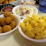 Sides include okra, coleslaw, and macaroni and cheese.