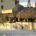 Tiki bar from table on the beach