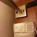Socket for charger on base of desk lamp
