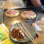 noodles in an omlete and cooking okonomiyaki