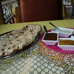 PESWARI NAAN (Fresh naan with coconut,and sweet raisins) served with assorted chutneys