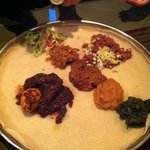 Injera with beef, chicken and vegetarian dishes