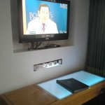 TV with desk fitted with nice blue light