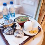 a 'welcome tray' with teas, water, biscuits etc.