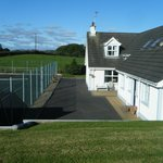 Tennis court and private guest entrance