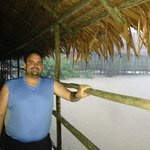 Walkway to the main bar at Explorama Lodge during a deluge