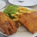 Cod fish and chips with mushy peas.