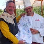 Chef Andrea  signs our Chef Coat in honor of our friend  Chef Joe Quigley