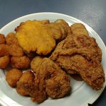 """True Southern fried chicken, corn fritters and flat corn bread """"hush puppies"""""""