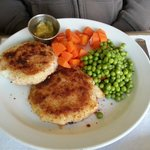 Home made fish cakes, boiled carrots, and peas