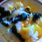 rice, soft-boiled egg and wakame seaweed