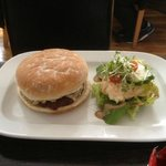 Burger served with salad