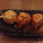 octopus balls. they also come in a serving of 5 and without cheese, probably a better option.