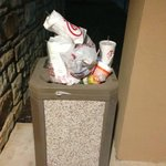 Trash located outside hotel left like this 2 days