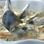 Mussels in creamy white wine sauce with garlic and fresh parsley