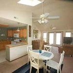 2 bed condo kitchen, dining and living room