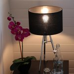 Nightstand with a very welcome refreshment and nice floral touch