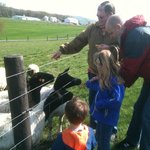 Mark with kids feeding sheep