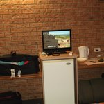 Wi-fi (free), plasma tv, fridge/kettle/microwave/toaster/iroining board/cupboard space/tea/coffe