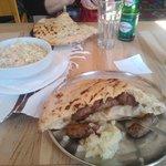 Delicious ćevapi served in pita bread with onions