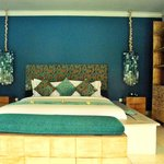 Beautifully designed bedroom with a HUGE king-sized bed and clean beddings.