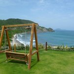 Swing seat at the end of the cliff villa road