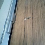 This was the door to our room which would not close due to the hinge being installed incorrectly