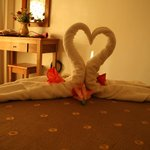 Towel swans and fresh flowers