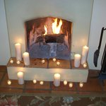 A second fireplace decorated with candles