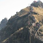 PEOPLE CLIMBING MOUNTAIN TOWARDS DATTAREYA TEMPLE JUNAGADH