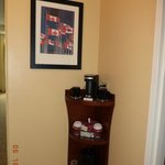 The coffee maker & tea provided in the room.