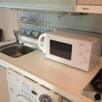 kitchenette with microwave, hot water boiler, stove