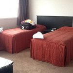 twin beds in living area, penthouse suite