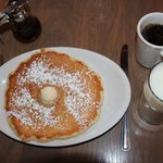 Pancake, syrup, milk and coffee