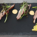 Smoked Duck Breast, with Vodka Melon Parisienne, fresh diced Mango, baby Leaves & a Butternut Sq