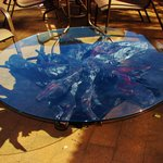 Puriri root coffee table with toughened glass top