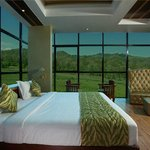 suite room with a forest veiw