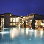 Private infinity-edge pool in night time